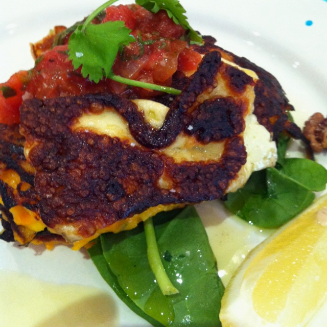 Pumpkin coriander fritters with haloumi (goat cheese), salsa, spinach ...