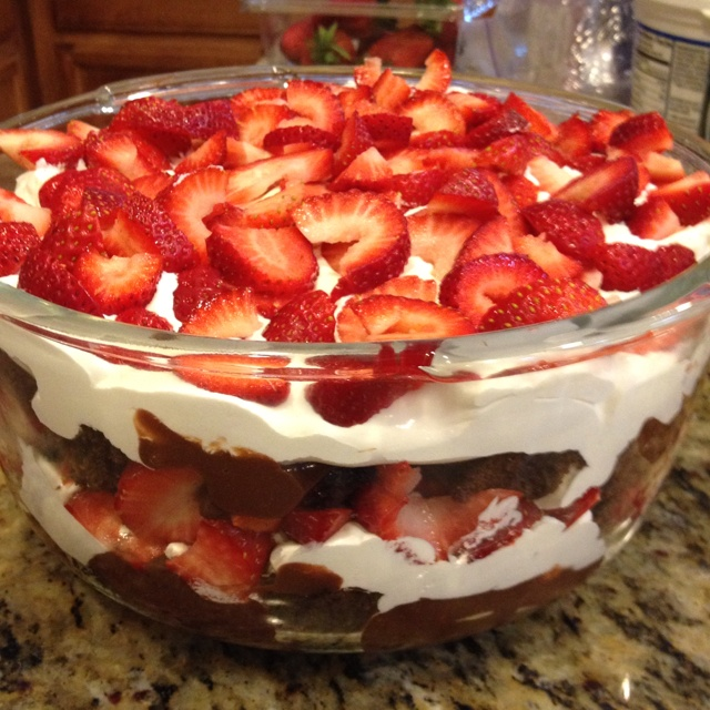 Brownies, chocolate pudding, whipped cream and fresh strawberries. So ...