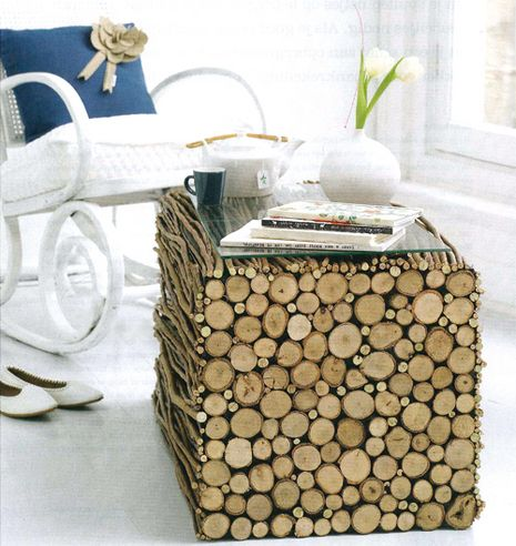 Very Cool Tree Branch Table. I must resist the urge to pull off a twig and make a curtain rod :)