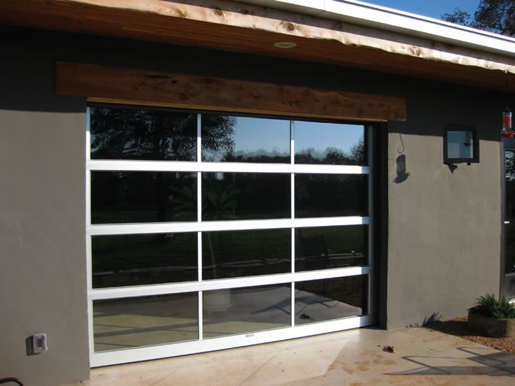 Glass garage door used as a patio door house features for Used patio doors