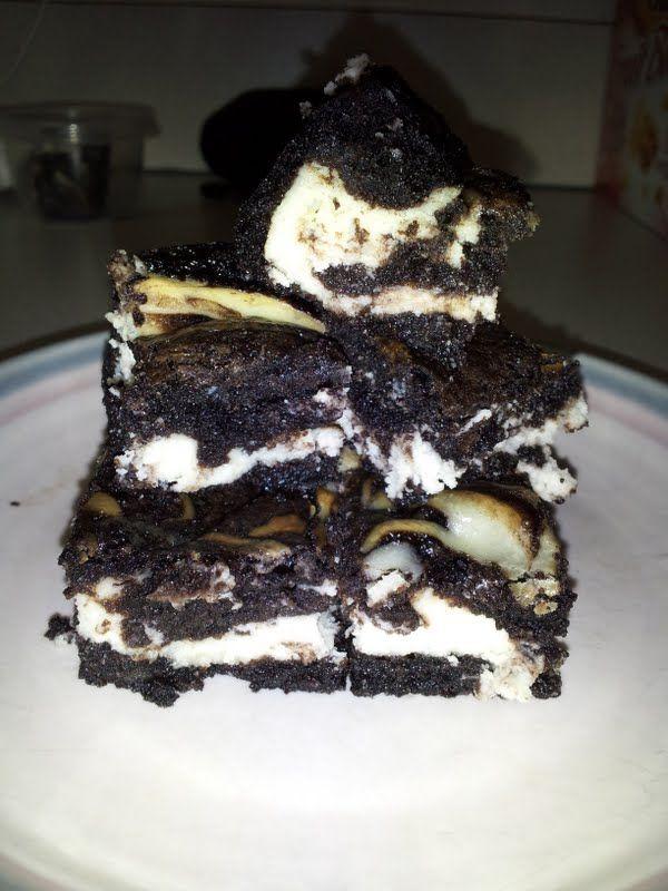 Dark chocolate cheesecake brownies made with cream and goat cheeses.