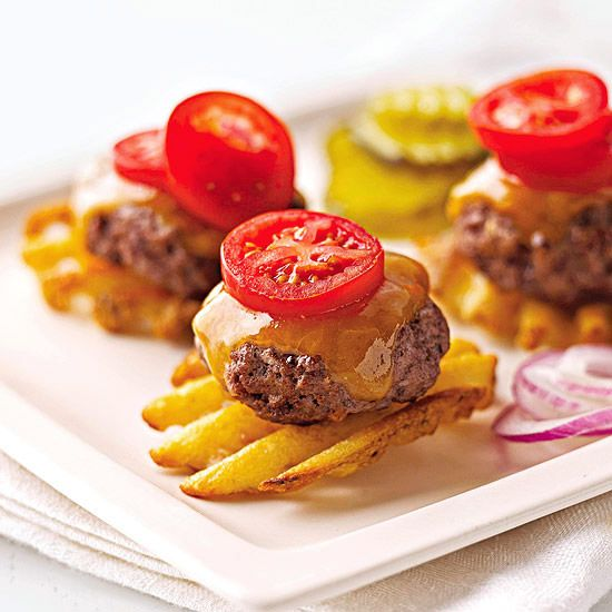 Burger Potato Bites - a waffle fry replaces the bun, then top with a burger & cheese and a cherry tomato slice. Perfect appetizer.