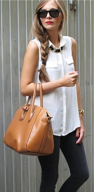 Skinny black jeans with sleeveless white shirt and oversize tan bag via DStyle Fashion.