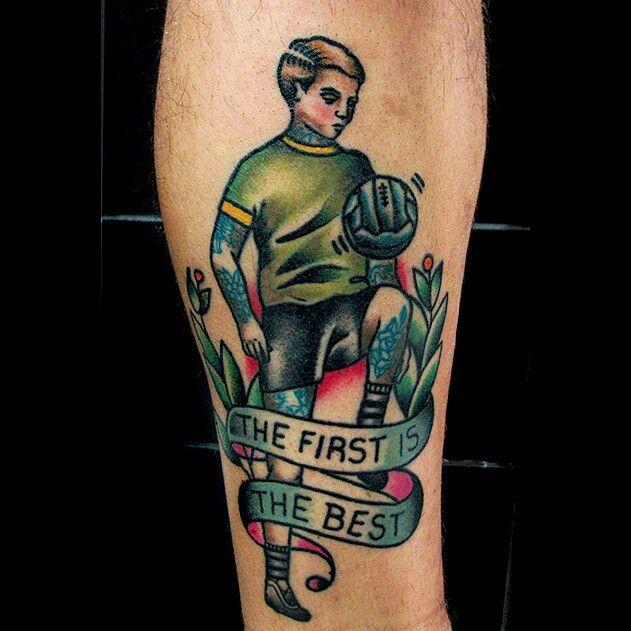Soccer ball tattoo on leg