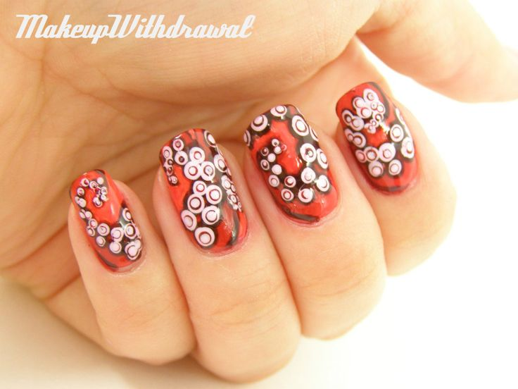 Makeup Withdrawal: Tentacle Nails  http://www.makeupwithdrawal.com/2012/08/tentacle-nails.html#
