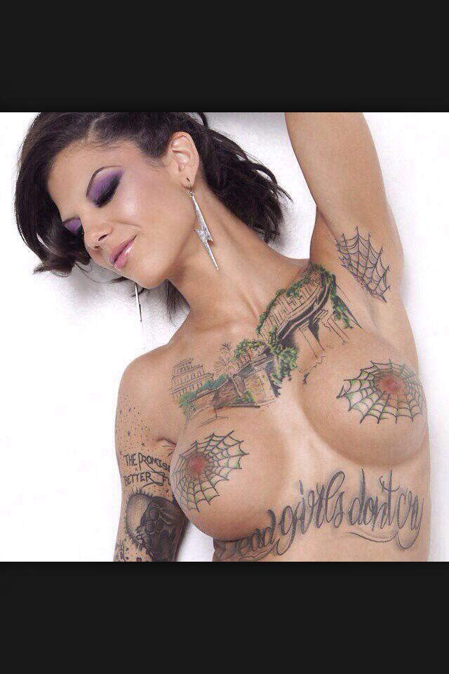 Spider web tattoos on tits
