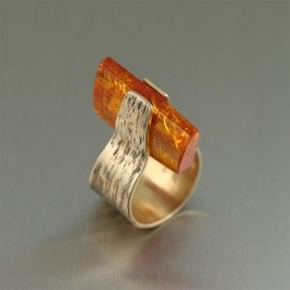 Treat your hand to the eclectic meeting of rustic charm and luminous elegance with the rich color and golden glow of this contemporary #Bronze #Amber Ring. The nature-inspired, #handcrafted bark texture is highlighted with a chip of rich #Amber.