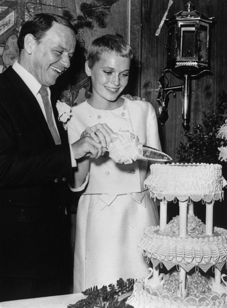 Frank Sinatra & Mia Farrow cutting the cake.