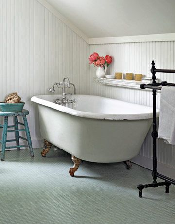 Don't have a clawfoot tub? Make one! This homeowner found a tub basin in a junk shop and added claw feet.     #bathrooms