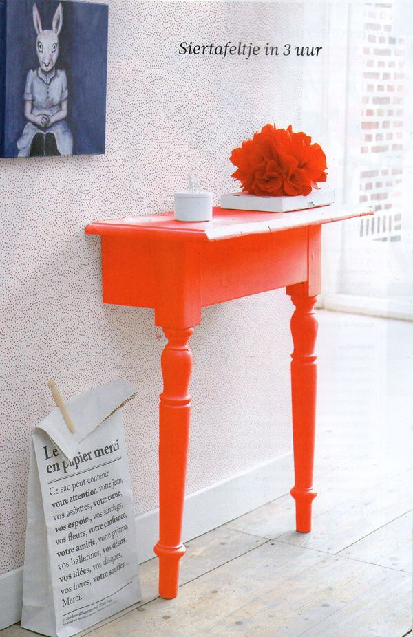 Brilliant! Table cut in half and painted a fabulous orange. use mounting brackets to stabilize . Great use of limited space, too...-- possibly for two bed side tables