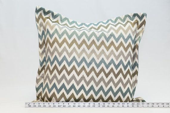 Custom made throw pillows. Blue, grey and brown embroidered pattern o?