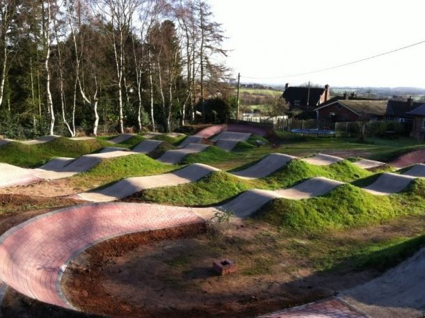 back yard bike track use dirt and 1 4 of the track to fit in the