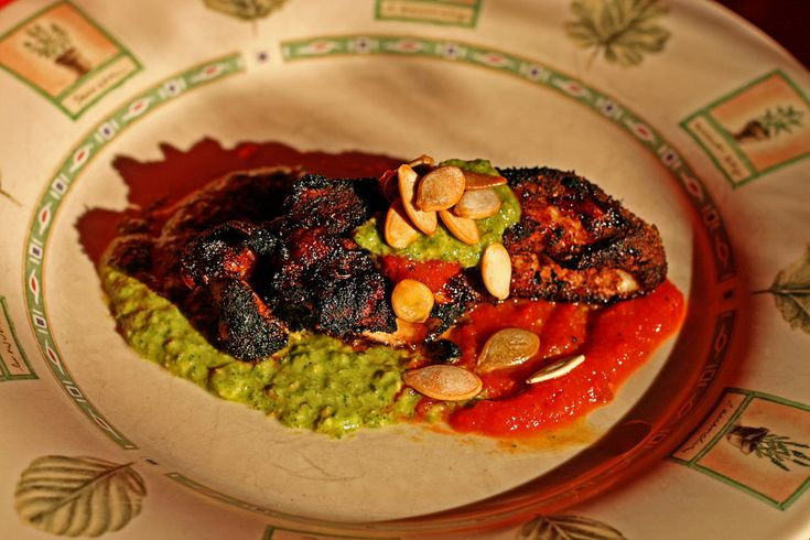 ... Chicken with Cilantro-Pumpkin Seed Sauce and Smoked Red Pepper Sauce