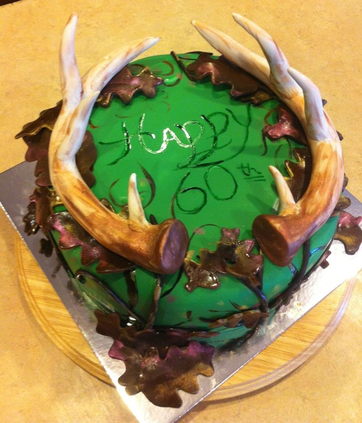 Deer antler cake,  antlers made with fondant, leaves and branches chocolate fondant. White cake with buttercream, covered with fondant.  First time making antlers.