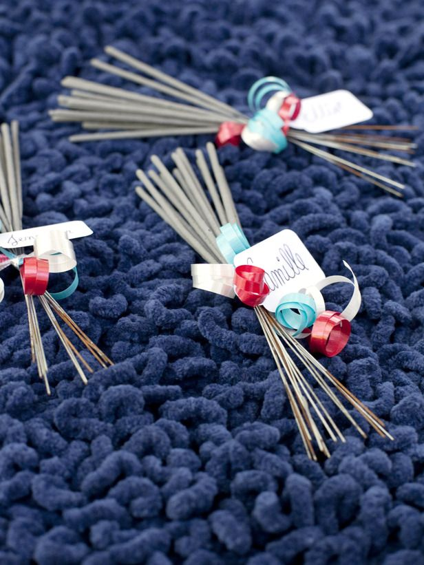 Sparkling Favors -   Instantly turn sparklers into placeholders or party favors with ribbon and paper tags.