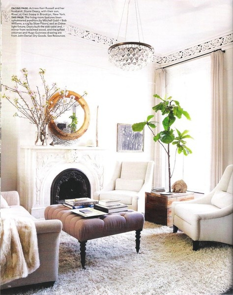 grey sofa, white chairs, white shag rug, gold accents