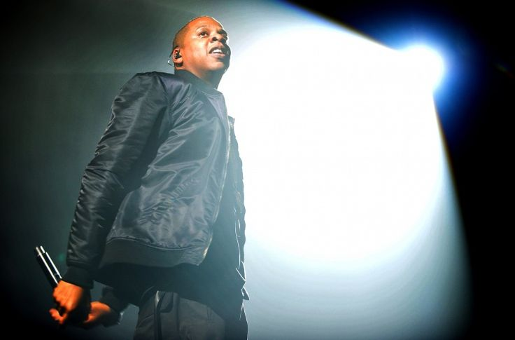 Magna Carta holy glow. The spotlight covers Jay-Z during a performance on Oct. 3 in Manchester, England