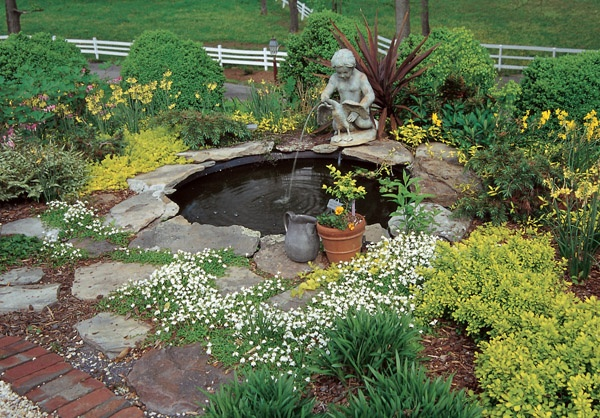 Pond garden with fountain flower beds landscaping for Flower garden ponds