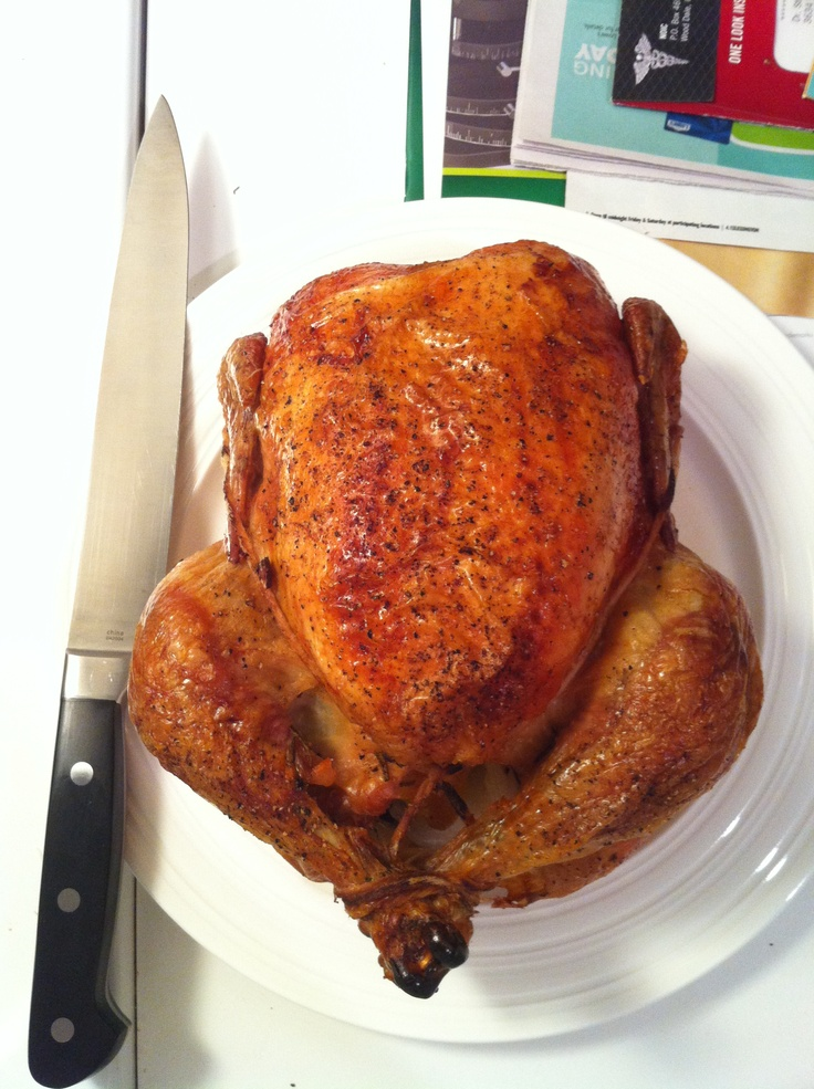 Roast chicken stuffed with rosemary, thyme, garlic, lemon, and butter ...
