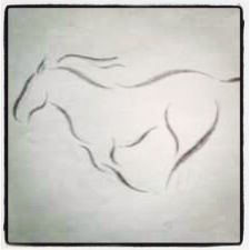 Horse tattoo. With the words wild and free