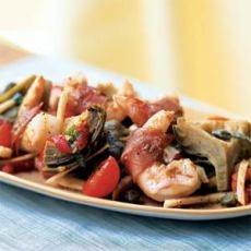Prosciutto-Wrapped Shrimp on Artichoke, Fennel, and Tomato Salad