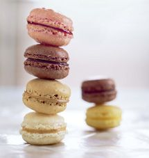 ... French macarons (Mah-Kah-ROHN) are almond-flavored sandwich cookies