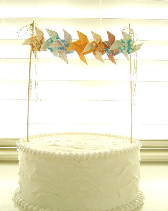 skewers/strawers to hold garland over cake