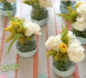 diy paint-dipped baby food jars = centerpieces