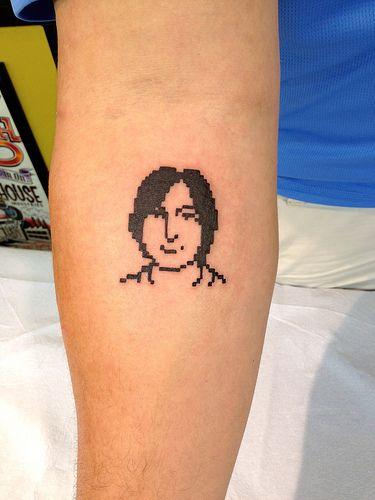 Steve Jobs 8-bit icon tattoo