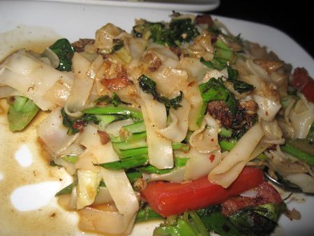 Noodles with Chinese broccoli, seasoned pork, tomato, mint,Thai basil ...