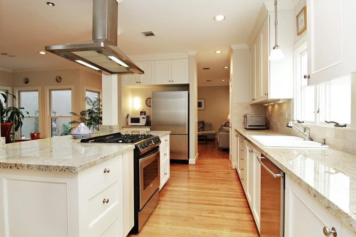 Cook s kitchen with gas range in island cabinets galore