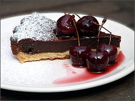 Chocolate Tart with cherries in Red Wine syrup