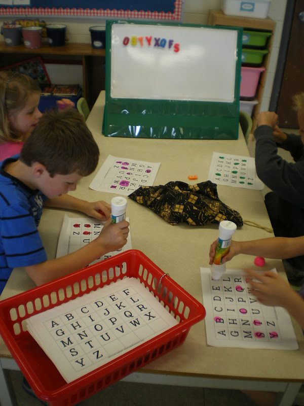 Pull a magnetic letter out a a bag and use a bingo marker to mark it off your sheet.