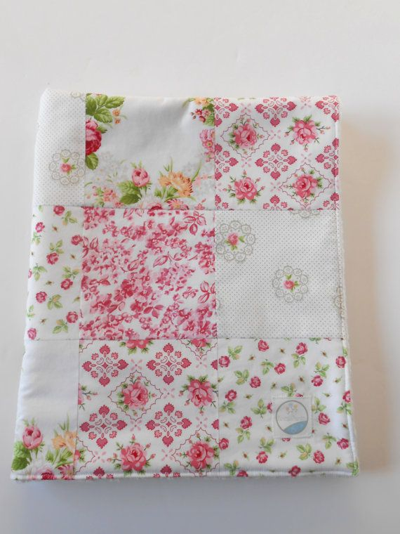 This is a minky patchwork quilt made with Hill Farm designed by Brenda Riddle of Acorn Quilts. Prints are cottage chic cabbage and shrub roses in light and deep pinks. Perfect for a Valentine's Day gift for a new baby girl.  The backing is super soft, high quality Ivory Dimple Dot Minky from Shannon Fabrics. There is a layer of Warm & White cotton needled batting between the layers. It is top stitched around the edges. See this & more in my shop.