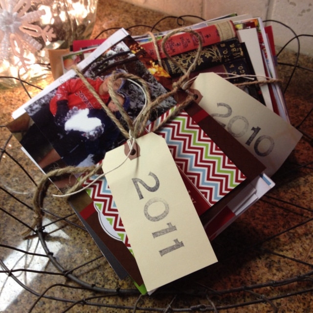 Christmas Cards bundled each year and put in basket as  part of decorations. I hate to throw out Christmas cards.