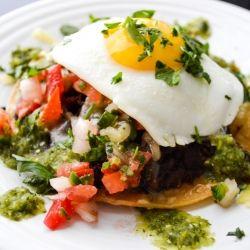 ... topped with black beans, carnitas, tomatillo salsa, and pico de gallo