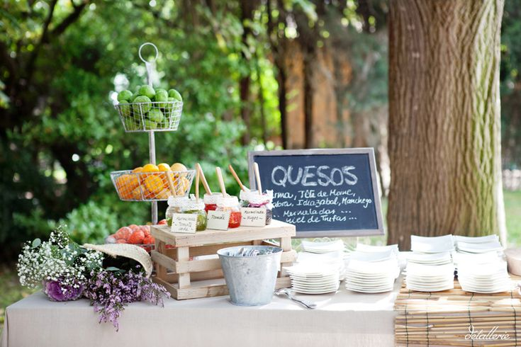 Cheese buffet. Mermelade and jam with cheese buffet. Decorating with flowers. Buffet decoration. Rustic wedding.