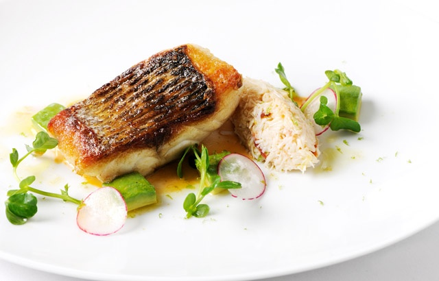 Pan-fried sea bass fillet with white crab salad and brown crab mayonn ...