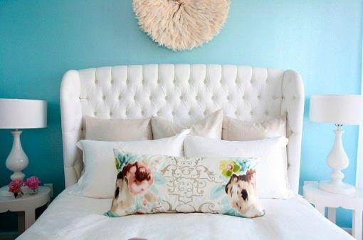 winged headboard, pillow arrangement, long colorful boudoir pillow