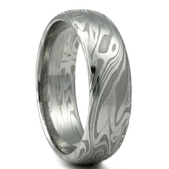 damascus steel mens wedding band four pointed swirling