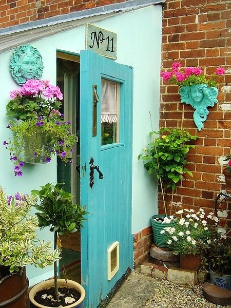 Cute little entryway - love the turquoise angels and of course, the door!