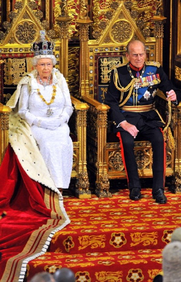 Queen Elizabeth II sits with Prince Philip, Duke of Edinburgh as she delivers her speech during the State Opening of Parliament in the House of Lords at the Palace of Westminster, 04.06.2014 in London, England.
