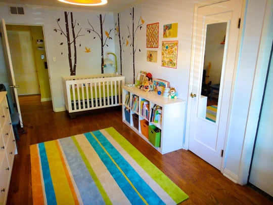 Striped rug--and board games on the wall