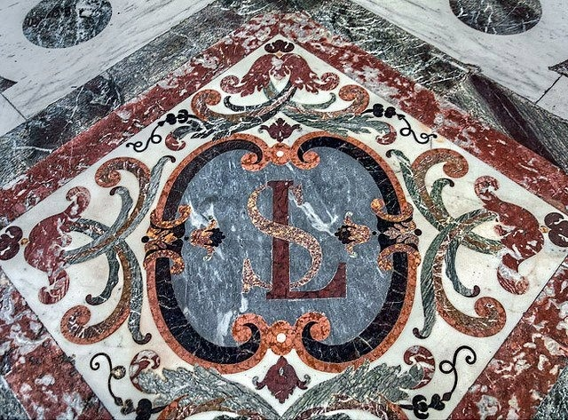 Inlaid marble floor with cipher of Louis XIV at the Royal Chapel at Château de Versailles