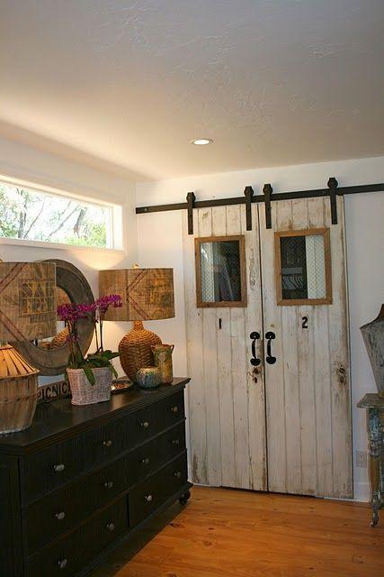 two old doors + barn door hardware = fantastic closet doors!