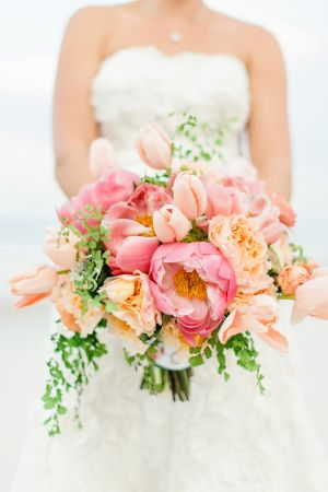 Lush bouquet consisting of blush and coral Peonies, Tulips, and Garden Roses. #wedding #flowers