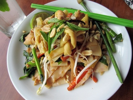 Spicy Thai Basil Noodles with Soft Tofu, Peanuts & Garlic Scapes