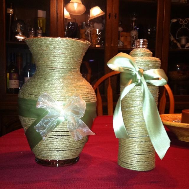 Unused flower vase and empty liquor bottle wrapped in hemp for Liquor bottle vases