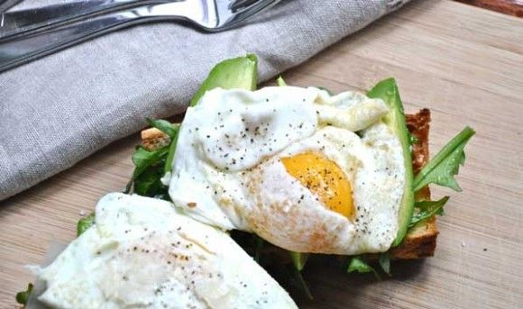 rustic avocado, arugula and fried egg open-face sandwich