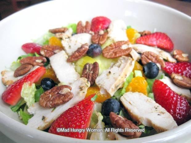 --The salad comprises of romaine, strawberries, blueberries, mandarin ...